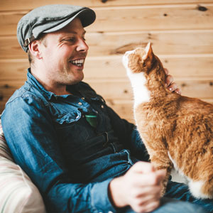 Man with ginger cat