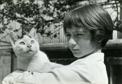 archive black and white photo of child holding a cat