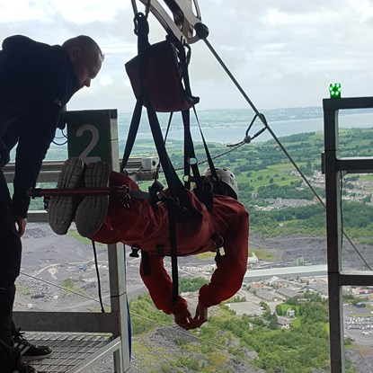 person getting ready for zipwire challenge