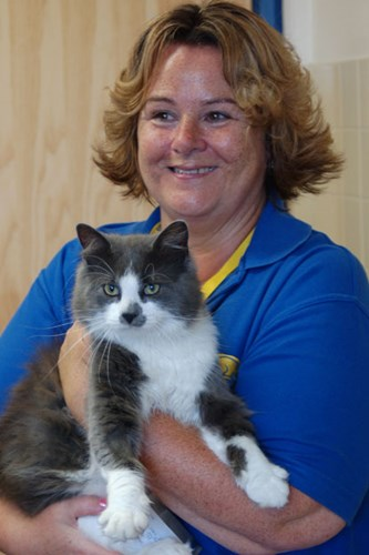 Cats Protection volunteer Tracy holding cat Baby