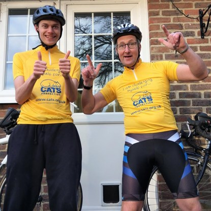 two men wearing Cats Protection cycling tops