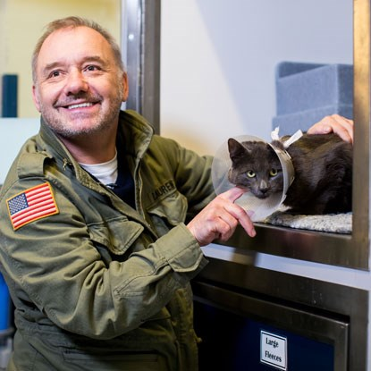 Bob Mortimer and cat DJ Loveham at Cats Protection
