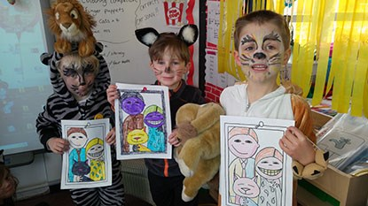 school boys dressed as cats with drawings