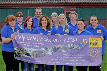 Cats Protection volunteers and staff holding a banner