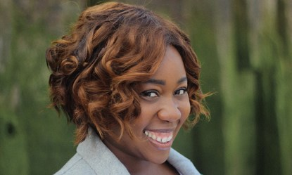 Actress Chizzy Akudolu smiling at camera