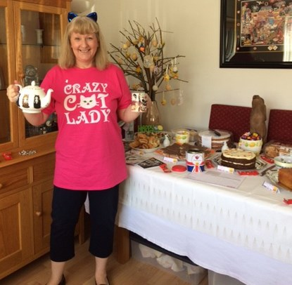 woman in crazy cat t-shirt cake sale spread