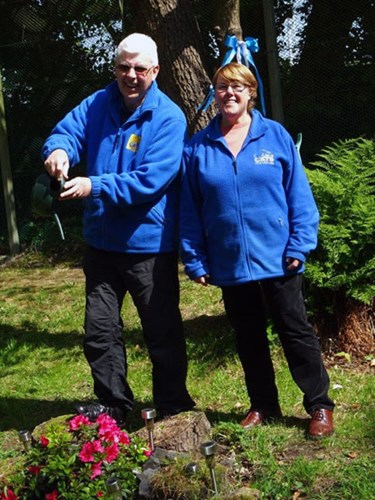 Two gardening volunteers in a Cats Protection garden