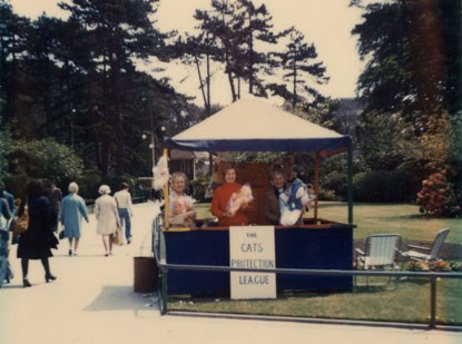 1960s photo of The Cats Protection League fundraising stall in a park