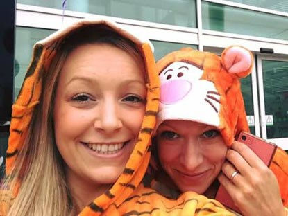 two women in tiger outfits with hoods