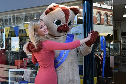 Rachel Riley with cat mascot outside Cats Protection shop
