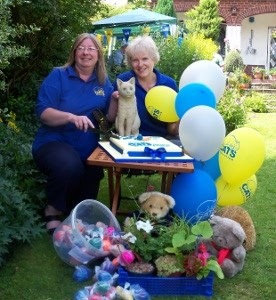 Cats Protection volunteers with stall and balloons