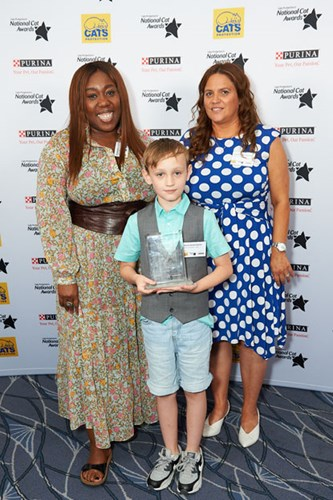 Winner of Hero Cat Award (Toby) Annette Sterland-Burton, her son Kieran and Chizzy Akudolu at the National Cat Awards 2018