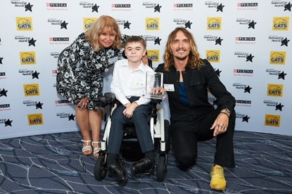 Winner of the Furr-ever Friends Award (Salem) Jared Bignold and his mother Verity with and Justin Hawkins at the 2018 National Cat Awards