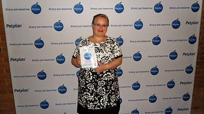 Cats Protection employee Claire Frangleton with award