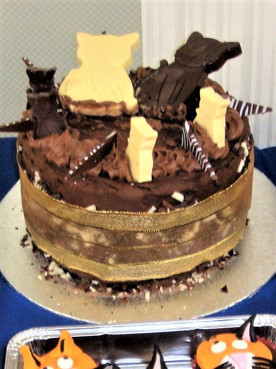 The Raffle Cake - mulit-layer sponge with milk and plain chocolated covered cat-shaped biscuits on top