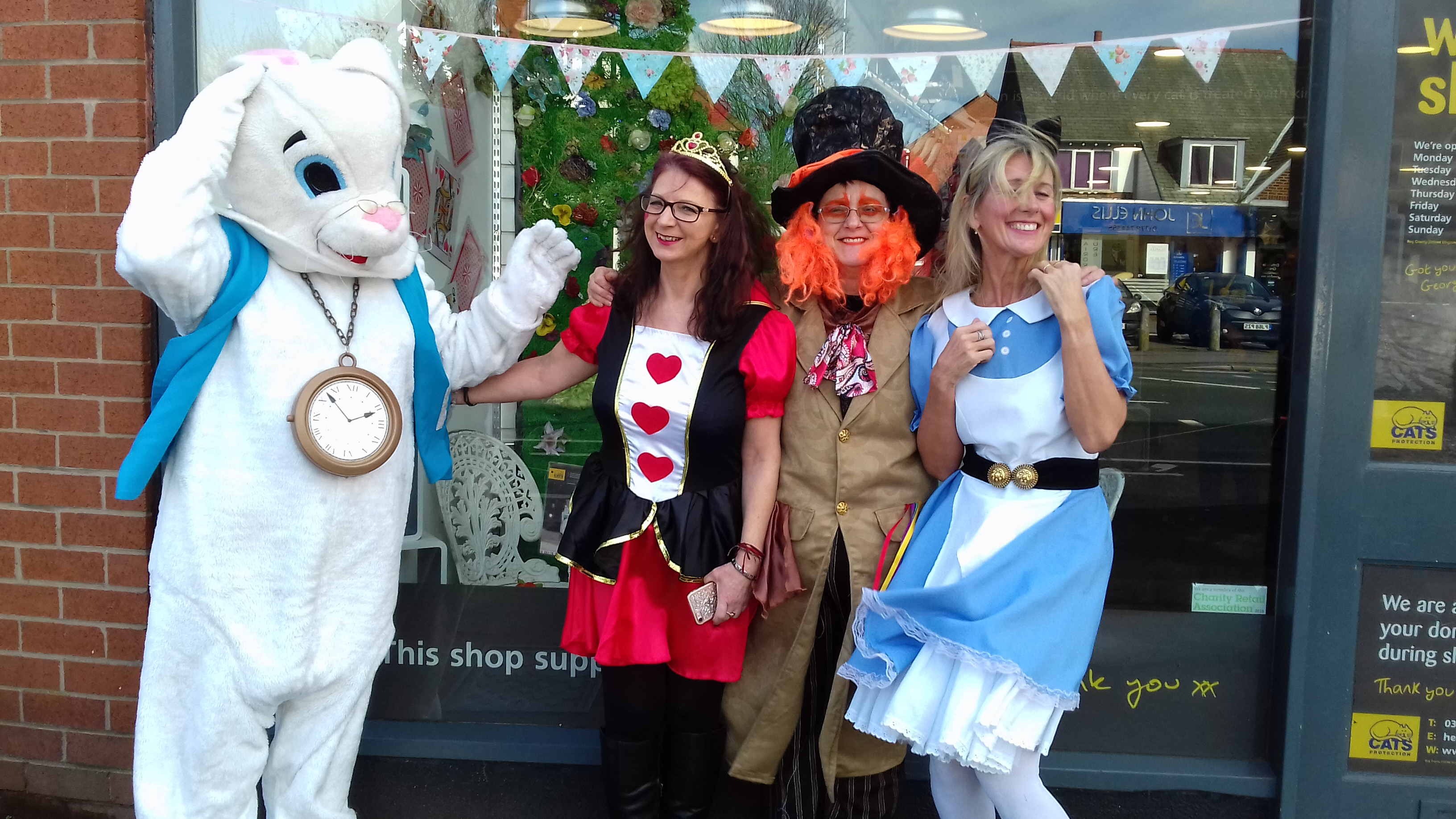 Shop staff and volunteers in fancy dress outside shop