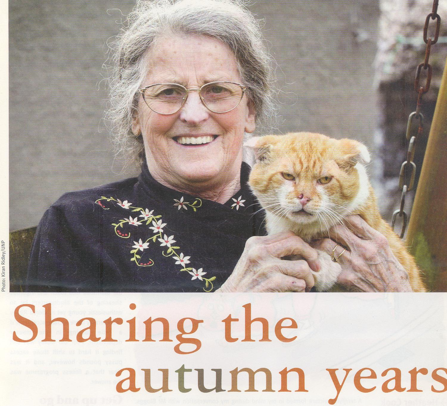 Older person with older cat