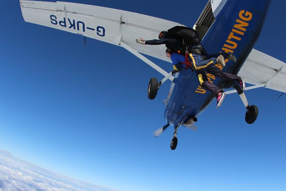 skydiving out of a plane