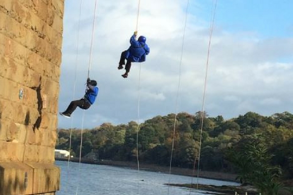 Forth rail abseilers in the air