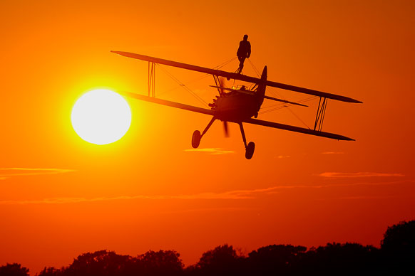wing walking at sunset