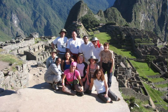 Participants at the top of Machu Picchu