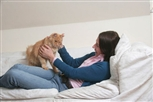 Woman on a sofa with a cat