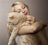 Cat being held by woman