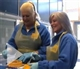 Kim Woodburn and Sam Fox volunteer!
