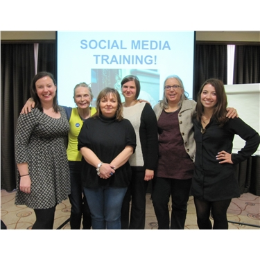 Volunteers socialise at social media training event