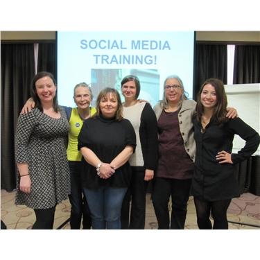 Volunteers socialise at social media training event