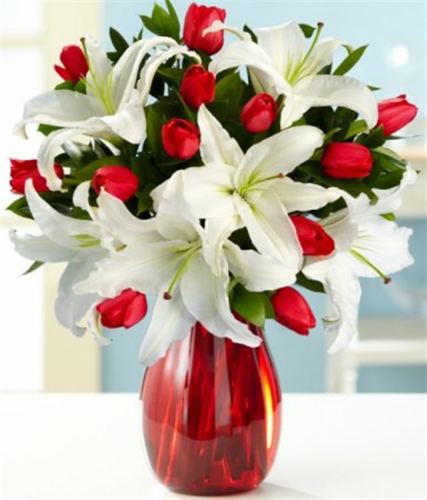 Vase with lilies showing the big stamens you should snip off